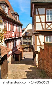 Narrow stepped street with traditional half timbered buildings in the town of Miltenberg, Bavaria, Germany