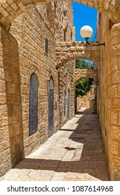 Narrow street among old stone houses in jewish quarter in Old City of Jerusalem, Israel (vertical composition).
