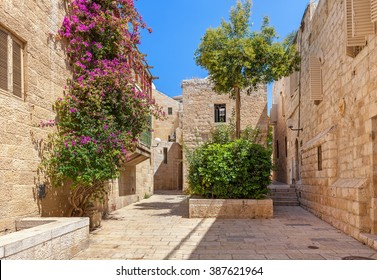 Narrow street among typical houses at Jewish Quarter in Old City of Jerusalem, Israel.