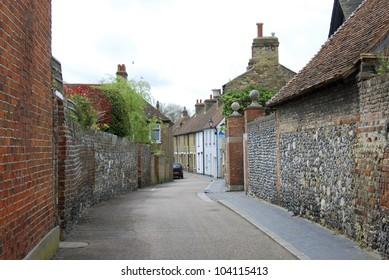 Narrow street with ancient walls, Sandwich, Kent, UK