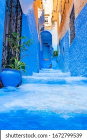 Narrow street in the blue city Chefchaouen, Morocco. Vertical