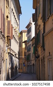 Narrow street in the center of Florence on a bright and sunny day