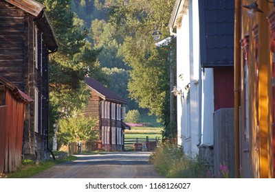 Narrow street with charming old wooden houses seen in the village of Tolga, Norway