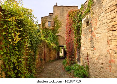 A narrow street in Cordes sur Ciel, a small medieval city on a hill in Southern France, near Albi and Toulouse
