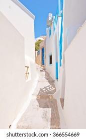 Narrow street in Fira town on Santorini (Thira), Greece.