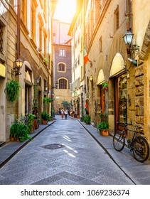 Narrow street in Florence, Tuscany, Italy. Architecture and landmark of Florence. Postcard of Florence