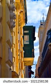 Narrow street with green balcony, Malta
