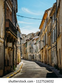 Narrow street in the historic centre of Arles, a city on the Rhone River in the Provence region of southern France