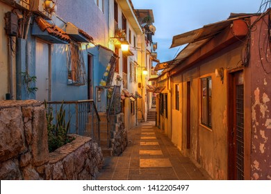 Narrow street in the historic quarter Barrio las Penas in Guayaquil, Ecuador at twilight.