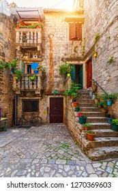 Narrow street in historic town Trogir, Croatia. Travel destination. Narrow old street in Trogir city, Croatia. The alleys of the old town of Trogir are very picturesque and full of charm. Croatia.