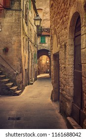 Narrow street of medieval ancient tuff city Pitigliano, travel Italy background