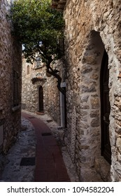 Narrow street and medieval stone houses in historical Eze village on French Riviera in France