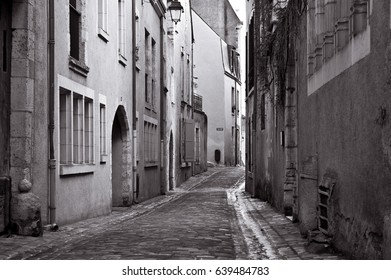 The narrow street of the medieval town of Blois / France / Europe/ Black and white photo