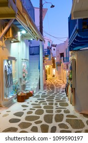 Narrow street in Mykonos town in the evening, Greece