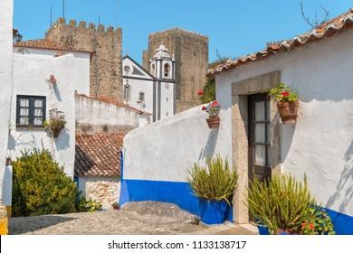 Narrow street near old Castle. Obidos, Estremadura, Portugal