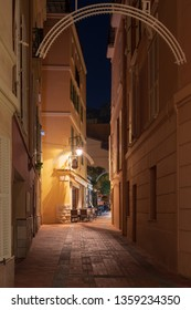 Narrow street in the night of Monaco-Ville old-town, is one of the four quarters of the Principality