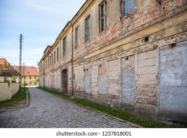Narrow street and old building in western Poland