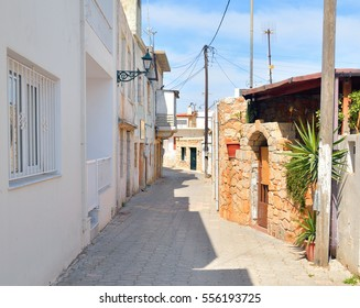 The narrow street with old houses in the historic part of Hersonissos, Crete, Greece.