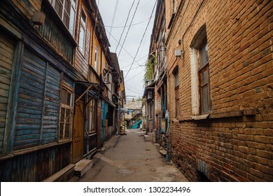 Narrow street in old poverty part of Astrakhan city in Russia