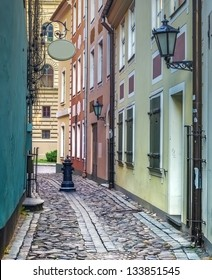 Narrow street in old Riga city, Latvia. In 2014, Riga is the European capital of culture.