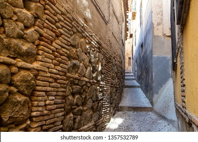Narrow street in old Toledo, Spain. Alleys and narrow streets.