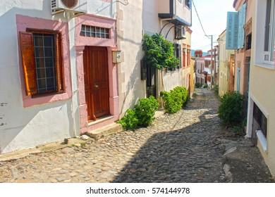 A narrow street of old touristic town, Cunda Alibey Island, Ayvalik. It is a small island in the northwestern Aegean Sea, off the coast of Ayvalik in Balikesir Turkey.