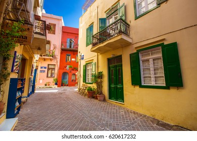 Narrow street in the old town of Chania, with colorful buildings, Crete, Greece on April 11, 2017.