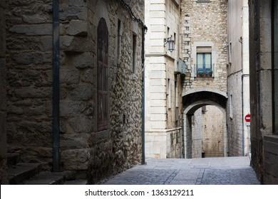 Narrow street in old town. Girona, Catalonia. Spain