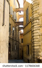Narrow street of old town of Siena, Toscana, Italy