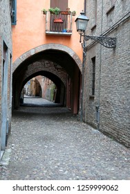 Narrow street on the city of Ferrara in Italy called Via delle Volte