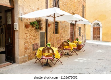 Narrow street on a spring day in small town Pienza, Tuscany