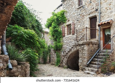 The narrow street in the picturesque village of Lanas in the Ardeche region in France.