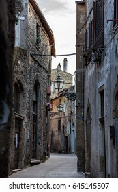 Narrow street of Pitigliano, a well-preserved medieval  town on a hilltop in Grosseto province, Tuscany, Central Italy.