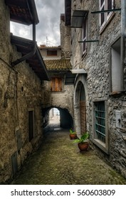 Narrow street in Riva di Solto next to Iseo Lake, Italy
