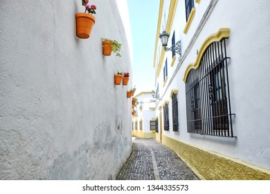A narrow street in Ronda, Spain