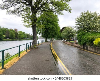 Narrow street running along side the Ness River in Inverness,  Scotland