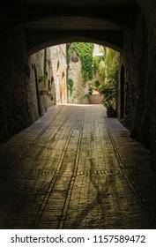 Narrow street of San Gimignano, ancient city in Toscana, Italy