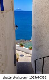 A narrow street in Sant Angelo descending to the promenade along the sea, Ischia, Italy.