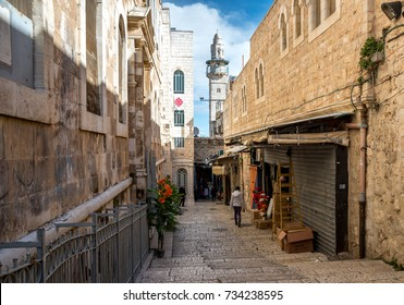 Narrow street situated in Jerusalem / Al-Quds old town, Armenian christian quarter. Mosque in background,Israel.