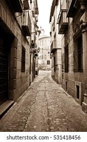 Narrow street of Spain in sepia, vintage colors