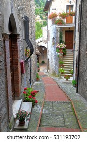 Narrow street and stone buildings from the medieval village of Scheggino, region of Umbria, Italy