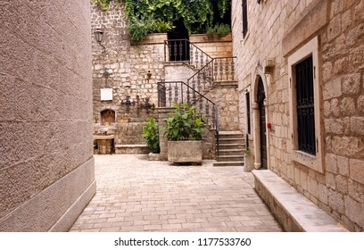 narrow street with stone stairs and shrine Kotor town Montenegro
