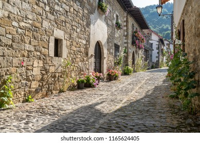 Narrow street with stone traditional houses. Spanish pyrenees.
