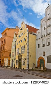 Narrow street with Three Brothers, which is complex of three medieval houses of seventeenth century in Riga, Latvia