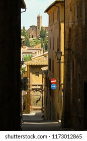 Narrow street of town of Siena, Toscana, Italy