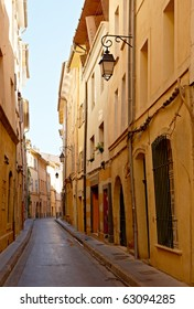 Narrow street with typical houses in Aix en Provence, France