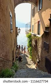 Narrow street in Varenna on Lake Como - Lecco, Lombardy, Italy