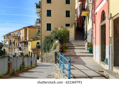 Narrow streets between houses of Riomaggiore town, Italy