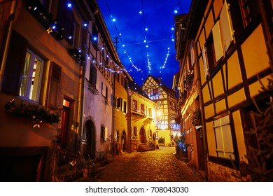 Narrow streets of Eguisheim, Alsace, France beautifully decorated for Christmas