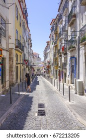 Narrow streets in historic district of Lisbon - LISBON / PORTUGAL - JUNE 14, 2017